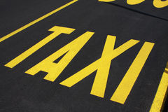 Taxi stop sign on the road Stock Photos