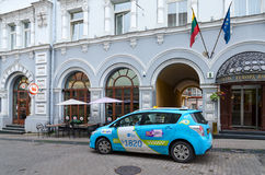 Taxi is on Street Ausros Vartai near four- star hotel Europe Roy Royalty Free Stock Image