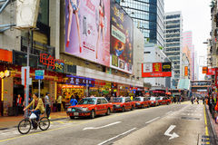 Taxi on the street of city Hong Kong Stock Images