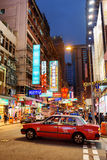 Taxi on the street of night city Hong Kong. Stock Photography