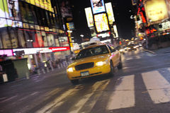 Taxi On Street At Night Stock Photography