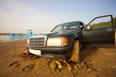Taxi stucked in the mud Stock Photo