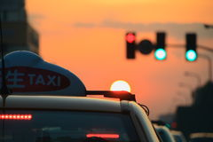 A taxi in sunset stock image