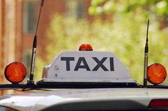 Taxi taxi. Detail photo of taxi sign on a taxi roof Stock Photos