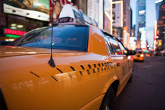 Taxi in Times Square. Yellow taxi cab with Times Square in background, New York City, U.S.A royalty free stock images