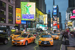 Taxi on Times Square. NEW YORK CITY - JULY 10: Taxi on Times Square, an iconic street of New York City and America, July 10, 2015 in Manhattan, New York City stock photo