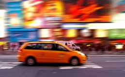 Taxi at Times Square in NYC. Taxi at times square at night in New York City royalty free stock images