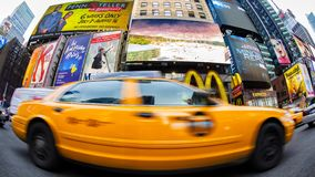 Taxi in Times Square. A yellow taxi on the move in Time Square New York stock photos