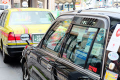 Taxi in tokyo japan. TOKYO, JAPAN - APRIL10, 2017 :Taxi cars on the street near the ueno station in Tokyo on APRIL10, 2017 in Tokyo, Several taxi cabs are Royalty Free Stock Images