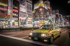Taxi in Tokyo at night stock images