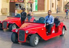 Taxi for tourists in park entertainment center Global Village in. DUBAI, UAE - DECEMBER 4, 2017: Taxi for tourists  in the park entertainment center Global Royalty Free Stock Photos