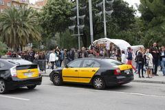 Taxi and tourists in the streets of Barcelona. Spain Stock Image