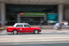 Taxi travel at business district of Hong Kong Stock Photography