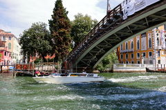 Taxi under the bridge Ponte dell'Accademia in Venice, Italy Royalty Free Stock Images