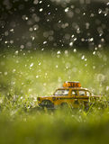 Taxi under the rain. Stock Photos