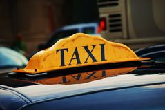 Taxi waiting in line for passengers. A taxi waiting in a queue for customers outside a busy urban area Royalty Free Stock Photos