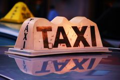 Taxi waiting passengers. A taxi waiting in a queue for customers in a busy urban area Stock Photography