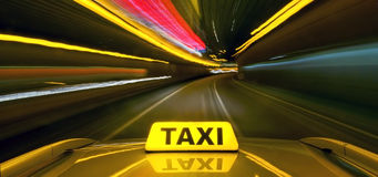 Taxi at warp speed. Taxi driving at high speed through the heavy traffic at night, seen from the roof of the cab stock photos
