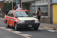 Taxi at work in Tokyo, Japan Royalty Free Stock Image