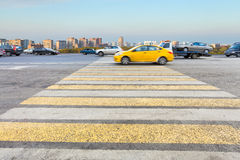 Taxi at yellow and white crossing zebra on street Royalty Free Stock Photos
