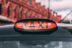 Taxi-Zeichen König-Cross Station London Stockfotos