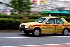 Taxi Zoom in Shinjuku. Taxi zooming through Shinjuku Ward of Tokyo, Japan Royalty Free Stock Image