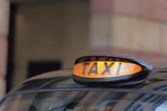 Taxiauto in Londen Stock Afbeeldingen