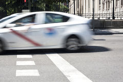 Taxicab crossing Madrid downtown Royalty Free Stock Photography