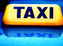 Taxicab sign. Taxi cab sign yellow on blue Royalty Free Stock Photos