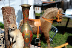 Taxidermy weasel and vase. rocking horse in background. flea mar Royalty Free Stock Photos