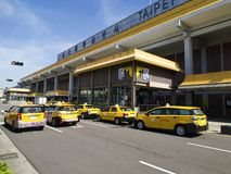 Taxies in Taipei Songshan Airport. Taipei, Taiwan - JUNE 27, 2015: Taxies line up for business in Taipei Songshan Airport on June 27,2015 in Taipei,Taiwan Royalty Free Stock Image
