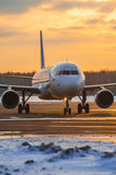 Taxiing Airbus A320 Ural Airlines on the platform of Moscow Domodedovo Airport at sunset Stock Photography