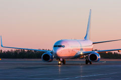 Taxiing aircraft in the airport. Taxiing aircraft in the morning crimson Royalty Free Stock Images
