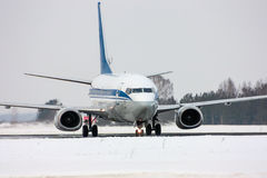 Taxiing aircraft on the main taxiway. Taxiing aircraft in a cold winter airport royalty free stock image