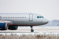 Taxiing aircraft in a winter airport. Taxiing aircraft in a cold winter airport Royalty Free Stock Photography