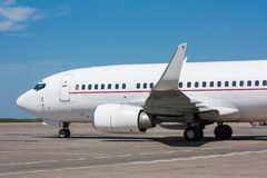 Taxiing airplane on the airport apron. Taxiing aircraft on the airport apron royalty free stock images
