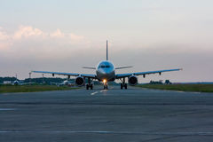 Taxiing airplane early in the morning. On the main taxiway royalty free stock image