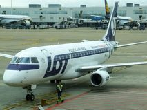 LOT Polish Airlines Embraer taxiing to the stand in Brussels airport in Belgium. Royalty Free Stock Image
