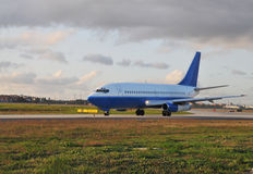 Taxiing Jetliner .. Commercial Passenger Aircraft travels down taxi way Stock Images