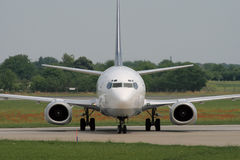 Taxiing after landing. Turning left to apron after landing Stock Photography