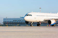 Taxiing passenger aircraft. On the airport apron stock photos