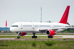 Taxiing plane from the runway Royalty Free Stock Photography