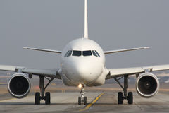Taxiing plane Stock Images