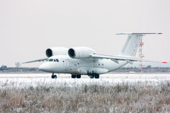 Taxiing rare aircraft in winter airport. Taxiing rare aircraft in cold winter airport Royalty Free Stock Image
