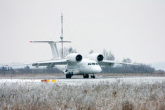 Taxiing rare aircraft in winter airport. Taxiing rare aircraft in cold winter airport royalty free stock photo