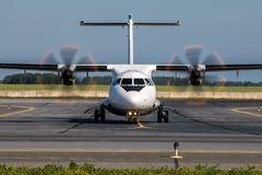 Taxiing turboprop airplane from the runway. Taxiing turboprop aircraft from the runway Royalty Free Stock Images