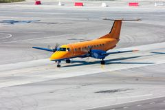 Taxiing turboprop airplane at the airport apron. Taxiing turboprop aircraft at the airport apron Royalty Free Stock Images