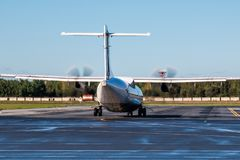 Taxiing turboprop airplane to the runway. Taxiing turboprop aircraft to the runway Royalty Free Stock Photography