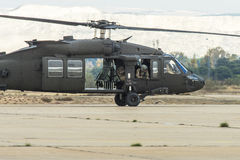 Taxiing in. US Army UH-60 Blackhawk returning from a mission at Zaragoza airbase in Spain during Trident-Juncture 2015. This was the biggest NATO exercise in Royalty Free Stock Photos