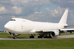 White plane. Taxiing of white cargo plane in Prague Stock Image